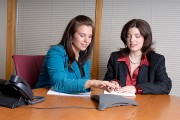 two businesswomen teleconferencing